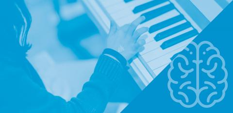 A person playing piano and brain icon on blue background